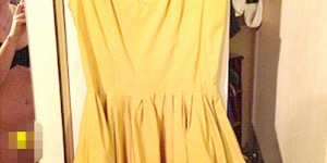 Woman Selling Dress on eBay Posts Naked Picture of Herself